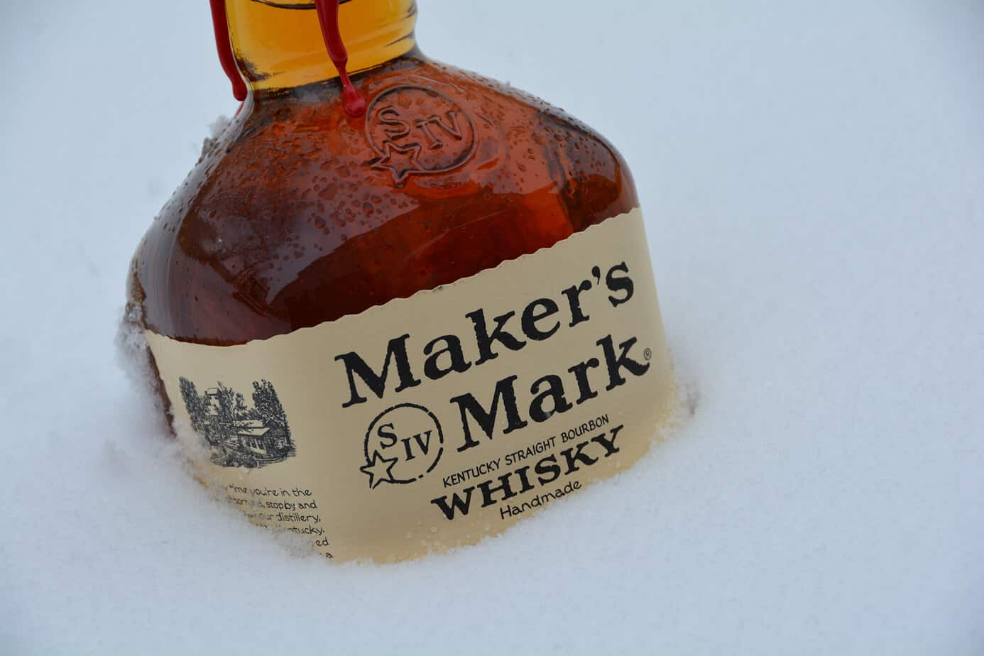 Photo of Makers Mark Kentucky Whiskey in snow